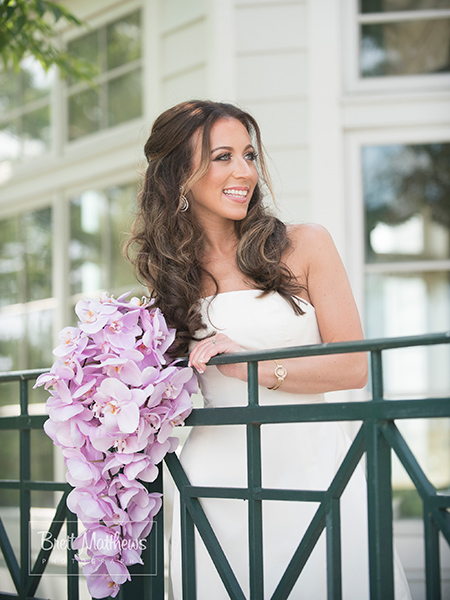 The bride with a cascading orchid bouquet.