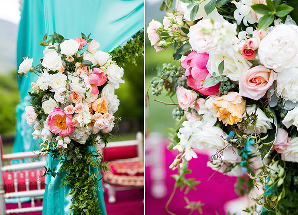 Roses, peonies, vines, berries, and hydrangeas on a wedding ceremony tent.