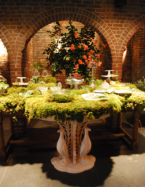 A moss-covered dessert table on the set of Girls
