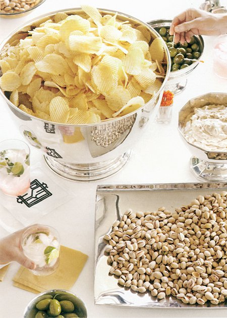 Chips and dips in silver bowls. (via Martha Stewart Living)