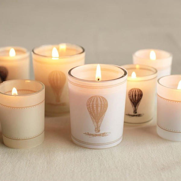 Vintage-style hot-air balloon wrapped votive holders.